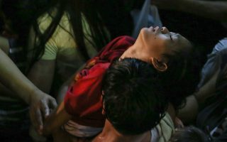 epaselect epa05094700 A Filipino devotee is carried away after getting unconscious during a procession as the image of Black Nazarene enters a church to end a 20 hours procession in Manila, Philippines, 10 January 2016. Two people died as more than a million barefoot devotees joined the Philippines' largest religious procession, honouring a centuries-old statue of Jesus Christ on Saturday, officials said. The feast of the Black Nazarene is one of the most celebrated religious events in the predominantly Catholic Philippines, where more than 80 per cent of the population professes the faith. The wooden statue, crowned with thorns and bearing a cross, is believed to have been brought from Mexico to Manila in 1606 by Spanish missionaries. The ship that carried it caught fire, but the charred statue survived and named the Black Nazarene.  EPA/MARK R. CRISTINO