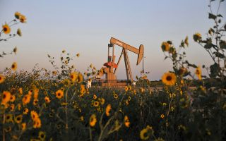 A pump jack operates at a well site leased by Devon Energy Production Company near Guthrie, Oklahoma in this September 15, 2015, file photo. U.S.