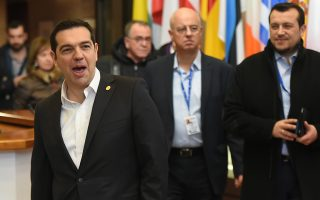 Greek Prime Minister Alexis Tsipras, left, leaves the EU Council building after an EU summit in Brussels on Friday, Feb. 19, 2016. The European Union has called an extraordinary summit with Turkey for early March to coordinate efforts to stem the flow of migrants across the Aegean into Greece. (AP Photo/Geert Vanden Wijngaert)