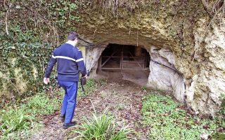A gendarme walks towards the entrance to the grotto where 48-year-old Jean-Luc Josuat was found outside Madiran, southwestern France, Saturday, Jan. 22, 2005. Jean-Luc Josuat has been pulled alive on Friday, Jan. 21 from a labyrinthine grotto where he was lost for 34 days, eating clay and wood to survive, after three teeanagers exploring the cave found his car near the entrance of the grotto. (AP Photo/Str)