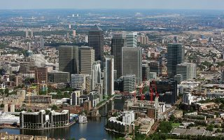 An aerial view of the Canary Wharf business district in eastern London is pictured from the