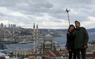 People take a selfie with the Bosphorus in the background in Istanbul, Turkey, December 15, 2015. REUTERS/Murad Sezer