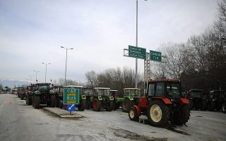 Tractors of protesting Greek farners are seen at Promachonas border crossing between Greece and Bulgaria, Greece February 17, 2016. Bulgarian truckers staged a counter-blockade on Tuesday at a checkpoint on the country's border with Greece, after Greek protesters failed to keep a promise to lift their own blockade for a few hours a day.  REUTERS/Stoyan Nenov