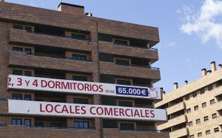 Signs advertise new apartments for sale in Sesena, Spain, on Saturday, April 14, 2012. Spanish debt risk climbed to a record for a second day and signaled a 37 percent chance the nation will default as its borrowing costs surged to levels that prompted its neighbors to seek bailouts. Photographer: Angel Navarrete/Bloomberg