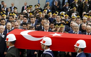 Turkish President Tayyip Erdogan, Prime Minister Ahmet Davutoglu and Chief of Staff General Hulusi Akar are seen in the background as honour guard carry the flag-draped coffin of Army officer Seckin Cil during a funeral ceremony in Ankara, Turkey, February 18, 2016. Army officer Cil was killed during the clashes between Turkish security forces and Kurdish militants in Sur district of the southeastern city of Diyarbakir. REUTERS/Umit Bektas