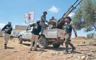 Σύροι αντικαθεστωτικοί αντάρτες γύρω από αντιαρματικό όπλο, κοντά στο χωριό Καφρ Νάσετζ. Η κατάρρευση της συμφωνίας για κατάπαυση του πυρός οδήγησε σε γενικευμένες συγκρούσεις σε πολλά σημεία της χώρας.