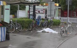 ATTENTION EDITORS - VISUAL COVERAGE OF SCENES OF INJURY OR DEATH A screen grab taken from video footage shows a covered body lying in a street following a shooting rampage at the Olympia shopping mall in Munich, Germany July 22, 2016.     REUTERS/Non-stop News/Handout via Reuters TV   GERMANY OUT   TPX IMAGES OF THE DAY  NO ARCHIVES. FOR EDITORIAL USE ONLY. NOT FOR SALE FOR MARKETING OR ADVERTISING CAMPAIGNS. THIS IMAGE HAS BEEN SUPPLIED BY A THIRD PARTY. IT IS DISTRIBUTED, EXACTLY AS RECEIVED BY REUTERS, AS A SERVICE TO CLIENTS. GERMANY OUT.  NO COMMERCIAL OR EDITORIAL SALES IN GERMANY.