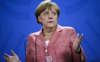 German Chancellor Angela Merkel briefs the media after a meeting with the members of Bosnian tripartite Presidency Bakir Izetbegovic, Mladen Ivanic and Dragan Covic at the chancellery in Berlin, Thursday, June 30, 2016. (AP Photo/Markus Schreiber)