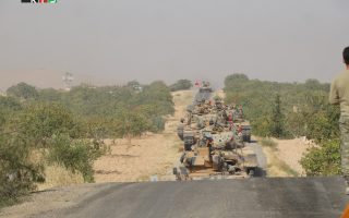 Turkish army tanks make their way towards the Syrian border town of Jarablus, Syria August 24, 2016. Picture taken August 24, 2016. Revolutionary Forces of Syria Media Office/Handout via REUTERS  ATTENTION EDITORS - THIS IMAGE WAS PROVIDED BY A THIRD PARTY. EDITORIAL USE ONLY. NO RESALES. NO ARCHIVE.