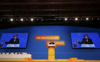 German Chancellor Angela Merkel and leader of the Christian Democratic Union (CDU) makes her keynote speech during the CDU party congress in Karlsruhe, Germany December 14, 2015.   REUTERS/Kai Pfaffenbach