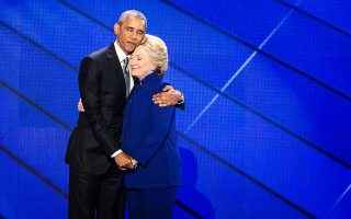 President Barack Obama hugs Democratic Presidential candidate Hillary Clinton after addressing the delegates during the third day session of the Democratic National Convention in Philadelphia, Wednesday, July 27, 2016. (Sean Simmers/PennLive.com via AP)
