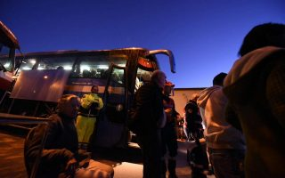 epa05610336 Displaced people prepare to leave Norcia (Umbria region) by bus following the strong earthquake that hit central Italy, 30 October 2016. A 6.6 magnitude earthquake struck 6km north of Norcia, Italy, on 30 October 2016.  EPA/MATTEO CROCCHIONI
