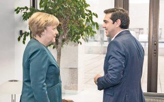 Ο Ελληνας πρωθυπουργός Αλέξης Τσίπρας με τη Γερμανίδα καγκελάριο Αγκελα Μέρκελ, κατά τη διάρκεια της συνάντησής τους στο περιθώριο της Συνόδου Κορυφής της Ευρωπαϊκής Ενωσης.