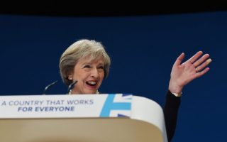 epa05566845 British Prime Minister, Theresa May delivers her speech during the Constervative Conference in Birmingham, Britain, 02 October 2016. May said that she would activate a mechanism to begin the process of the UK's withdrawal from the European Union - known as the Article 50 of the Lisbon Treaty - before the end of March 2017.  EPA/FACUNDO ARRIZABALAGA