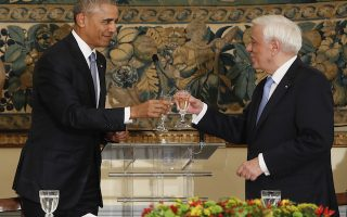 US President Barack Obama and Greek President Prokopis Pavlopoulos share a toast during a State Dinner at the Presidential Mansion, Tuesday, Nov. 15, 2016. (AP Photo/Pablo Martinez Monsivais)