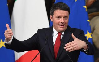 epa05651139 Premier Matteo Renzi during his speech at a joint press conference with Economy Minister Pier Carlo Padoan (not pictured) in the Chigi Palace, Rome, Italy, 28 November 2016. The 2017 budget bill won't change in the event of a No win in the 04 December Constitutional reform referendum, Renzi said. 'It is a budget bill that is well constructed and no one will be able to call into question its pillars,' he added.  EPA/ALESSANDRO DI MEO