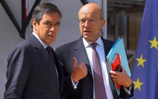 Ο Φρανσουά Φιγιόν (αριστερά) και ο Αλέν Ζιπέ (δεξιά) θα είναι αντιμέτωπει στο Β' γύρο των εσωκομματικών εκλογών για το προεδρικό χρίσμα των Γάλλων Ρεπουμπλικανων.