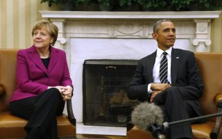 U.S. President Barack Obama meets with German Chancellor Angela Merkel to discuss the crisis in Ukraine at the White House in Washington February 9, 2015. The leaders of Russia, Ukraine, Germany and France agreed to meet in Belarus on Wednesday to try to broker a peace deal for Ukraine amid escalating violence there and signs of cracks in the transatlantic consensus on confronting Vladimir Putin. REUTERS/Kevin Lamarque (UNITED STATES - Tags: POLITICS CIVIL UNREST)