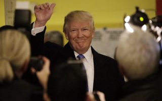 epa05622829 Republican presidential candidate Donald Trump waves to reporters after voting at Public School 59 on the eastside in New York, New York, USA, 08 November 2016. Americans vote on Election Day to choose the 45th President of the United States of America to serve from 2017 through 2020.  EPA/Peter Foley