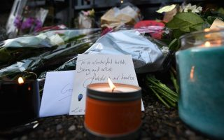 epa05688641 Flowers and tributes lay outside the home of late British singer-songwriter George Michael in London, Britain, 26 December 2016. Michael died at his home in Goring, Oxfordshire on 25 December. He was 53.  EPA/ANDY RAIN
