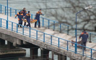 epa05687860 Rescuers carry fragments and remains, found at the site of the Tu-154 plane crash near Sochi, Russia, 25 December 2016. According to media reports, a Tupolev-154 Russian airplane carrying at least 92 people disappeared from radar and crashed into the Black Sea after taking off from an airport in Sochi on 25 December. The plane which was flying to Latakia, Syria, was reportedly carrying 65 members of the Alexandrov Ensemble, eight crew members, nine Russian journalists as well as Russian civil activist, Doctor Yelizaveta Glinka (Doctor Liza).  EPA/YEVGENY REUTOV