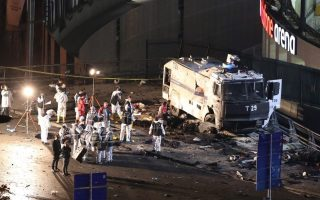 epa05669924 Crime scene investigators work next to a damaged water cannon at the scene of an explosion around Vodafone Arena Stadium in Istanbul, Turkey, 10 December 2016. At least 20 people were wounded in what the Interior Ministry called a car bomb attack after two explosions were heard outside Besiktas Stadium a few hours after the night's soccer match  EPA/TOLGA BOZOGLU