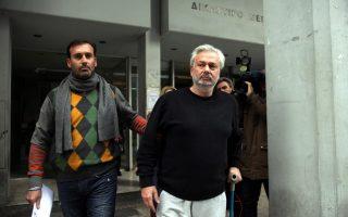 Ο Ιωάννης Καρούζος (Δ) συννελήφθη στις 30 Δεκεμβρίου του 2012.