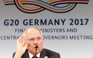 epa05856474 German Finance Minister Wolfgang Schaeuble speaks during a news conference during the G20 Finance Ministers and Bank Governors meeting in Baden Baden, Germany, 18 March 2017. The meeting of G20 Finance Ministers and Central Bank Governors took place in Baden-Baden on 17 to 18 March and was chaired by Germany.  EPA/RONALD WITTEK