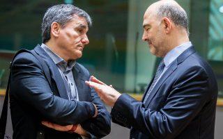 Ευκλείδης Τσακαλώτος και Πιερ Μοσκοβισί συζητούν στο περιθώριο του χθεσινού Eurogroup.