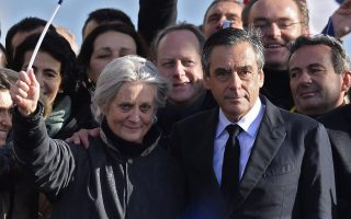 epa05876061 (FILE) A file picture dated 05 March 2017 'Les Republicains' party candidate for the 2017 French presidential elections, Francois Fillon (L) flanked by his wife Penelope (R) acknowledge cheers from the crowd after his speech during a meeting organized to support him on the Place du Trocadero in Paris, France. According to news reports late 28 March 2017, Penelope is now charged and under formal investigation over 'fake jobs' row, after appearing before investigating judges. Francois Fillon has been accused of improperly paying his wife and two of his children nearly a million euros in state funds for work they allegedly didn't do.  EPA/IAN LANGSDON