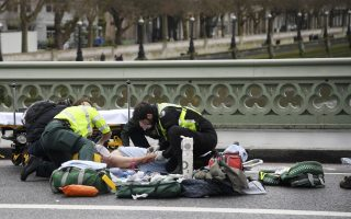 Paramedics treat an inured person after an incident on Westminster Bridge in London, March 22, 2017.  REUTERS/Toby Melville