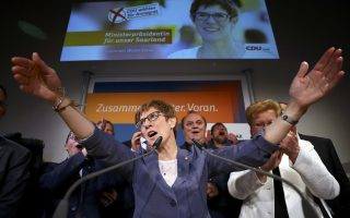 Annegret Kramp-Karrenbauer, State Minister-President and top candidate of the Christian Democratic Union Party (CDU) reacts after the Saarland state elections in Saarbruecken, Germany, March 26, 2017.       REUTERS/Kai Pfaffenbach