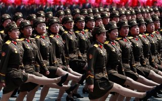 epa05909232 North Korean soldiers march during a parade for the 'Day of the Sun' festival on Kim Il Sung Square in Pyongyang, North Korea, 15 April 2017. North Koreans celebrate the 'Day of the Sun' festival commemorating the 105th birthday anniversary of former supreme leader Kim Il-sung on 15 April as tension over nuclear issues rise in the region.  EPA/HOW HWEE YOUNG
