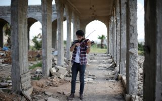 Ameen Miqdad, a violinist from Mosul who lived under ISIS's rule for two and a half years where they destroyed his musical instruments, performs in eastern Mosul, Iraq, April 19, 2017. REUTERS/ Muhammad Hamed