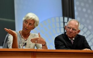 IMF Managing Director Christine Lagarde (L) and German Finance Minister Wolfgang Schauble (R)  attend a panel discussion at the annual meetings of the IMF and World Bank Group in Washington, October 6, 2016. REUTERS/James Lawler Duggan