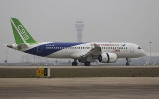 China's home-grown C919 passenger jet lands during its first flight at Pudong International Airport in Shanghai, China May 5, 2017. China Daily/via REUTERS ATTENTION EDITORS - THIS IMAGE WAS PROVIDED BY A THIRD PARTY. EDITORIAL USE ONLY. CHINA OUT.