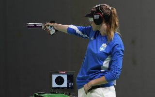 epa05461329 Anna Korakaki of Greece takes aim during the women's 10m Air Pistol final of the Rio 2016 Olympic Games Shooting events at the Olympic Shooting Centre in Rio de Janeiro, Brazil, 07 August 2016. Korakaki won the bronze medal.  EPA/VALDRIN XHEMAJ