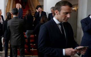 French President Emmanuel Macron (R) and Prime Minister Edouard Philippe (L) use their smartphones after a family photo after the first cabinet meeting at the Elysee Palace in Paris, May 18, 2017.  REUTERS/Philippe Wojazer/Pool      TPX IMAGES OF THE DAY