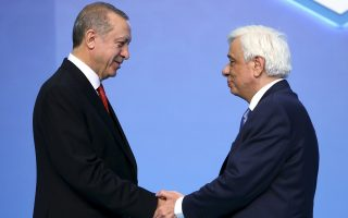 Turkey's President Recep Tayyip Erdogan, left, greets Greece's President Prokopios Pavlopoulos at the 25th Anniversary Summit of the Organization of the Black Sea Economic Cooperation (BSEC) in Istanbul, Monday, May 22, 2017. (Pool Photo via AP)