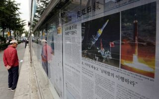 A South Korean newspaper shows images of North Korean ballistic missile, in Seoul, South Korea, Tuesday, May 16, 2017. The U.N. Security Council is strongly condemning North Korea's latest ballistic missile test and vowing to impose new sanctions in response to its