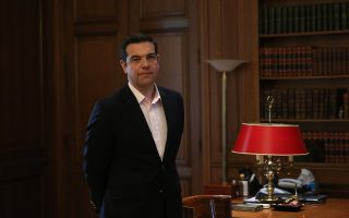 epa05943411 Greek Prime Minister Alexis Tsipras waits in his office to meet Minister of State of United Arab Emirates  Sultan Bin Ahmad Al Jaber (not in photo), in Athens, Greece, 04 May 2017.  EPA/ORESTIS PANAGIOTOU
