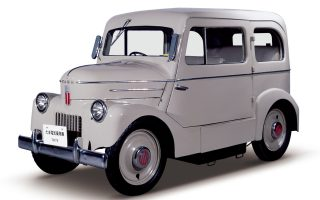 During the 1940sÕ switch to a peacetime economy, Tachikawa Aircraft (later Tama Cars Co.) embarked on the development of electric vehicles. One reason for this was the extreme shortage of gasoline at the time. In 1947, the company succeeded in creating a prototype 2-seater truck (500-kg load capacity) with a 4.5-horsepower motor and a new body design. It was named Tama after the area where it was produced. Its top speed was 34 km/h (21 mph). Next, the company created its first passenger car. With two doors and seating for four, it boasted a top speed of 35 km/h (22 mph) and a cruising range of 65 km (40 miles) on a single charge. The former aircraft maker employed many unique ideas in the design and construction of the Tama, such as its battery compartments.
