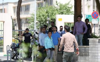 People gather near the parliament's building during a gunmen attack in central Tehran, Iran, June 7, 2017. TIMA via REUTERS ATTENTION EDITORS - THIS IMAGE WAS PROVIDED BY A THIRD PARTY. FOR EDITORIAL USE ONLY.