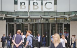 An entrance to the headquarters of the publicly funded BBC in London, Wednesday, July 19, 2017. The BBC published the names and salaries of its highest-earning actors and presenters, Wednesday, compelled by Britain's government to publish the salaries of on-air talent which had previously been secret, revealing that its highest-paid star, radio host Chris Evans, earns more than 2.2 million pounds ($2.9 million) a year. (AP Photo/Frank Augstein)