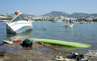 Damaged boats are seen after an earthquake and a tsunami in the resort town of Gumbet in Mugla province, Turkey, July 21, 2017. REUTERS/Kenan Gurbuz