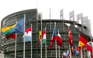 Flags of 25 European nations fly in front of the European parliament in Strasbourg, eastern France, Tuesday July 20, 2004, as the newly-elected parliament, which includes representatives from the ten new European Union members, convenes for the first time. (AP Photo/Cedric Joubert)