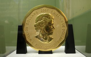 FILE - The Dec. 8, 2010 photo shows the  'Big Maple Leaf' coin in the Bode Museum in Berlin.  Special police units in Germany have raided several homes in Berlin on Wednesday, July 12, 2017  in connection with a 100-kilogram (221-pound) gold coin stolen from the museum.  (Marcel Mettelsiefen/dpa via AP)