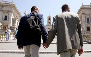epa000439289 A gay couple climbs hand-by-hand towards the central Campidoglio square, where the Rome City Hall is situated, Saturday, 21 May 2005, during the Pacs Day, when dozens of gay, lesbian, and heterosexual couples will be symbolically united in a civil pact in presence of city council members from different Italian cities. The event is organized by the most important Italian gay organization