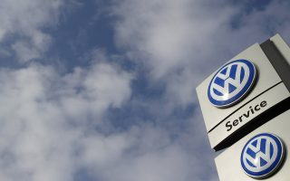 A sign of a Volkswagen VW car dealer is seen in Bochum, Germany March 16,2016.  The judgement in a trial of a Volkswagen car owner who sued a German VW dealership, demanding the seller cancel the contract and take back his Tiguan diesel compact car, one of the models affected by the automaker's emissions test cheating scandal, is expected today. REUTERS/Ina Fassbender