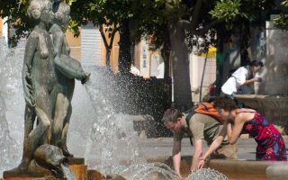 People cool off at a fountain in Valencia, eastern Spain, Thursday, Aug. 7, 2003. A heatwave is currently hitting the Iberian peninsula with temperatures reaching 40 degrees centigrade (104 fahrenheit) or more in some areas of central Spain. (AP Photo/Ramon Espinosa)